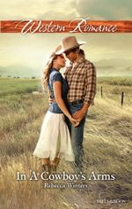 In A Cowboy's Arms : Hitting Rocks Cowboys Book 1 - Rebecca Winters